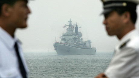 Chinese Navy officers wait dockside as a Chinese Navy warship escorting the arrival of the USS Curtis Wilbur (DDG54), a US Navy AEGIS class guided missile destroyer, arrives at Qingdao port, Qingdao, in eastern China's Shandong province. File photo. © Frederic J. Brown