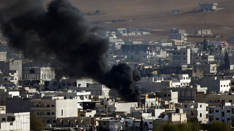 File Photo. Smoke rises from the Syrian town of Kobani. October 15, 2014. © Kai Pfaffenbach