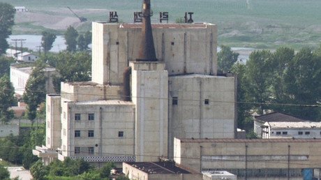 A North Korean nuclear plant is seen before demolishing a cooling tower (R) in Yongbyon © KYODO