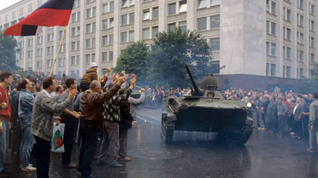 Following Yeltsin's speech and witnessing mass opposition by the people, some of the military units surrendered to avoid bloodshed relinquishing control of their hardware to masses. © Sergey Guneev