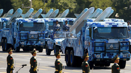 Marine corps vehicles carrying ship-to-air missiles drive past the Tiananmen Square during the military parade marking the 70th anniversary of the end of World War Two, in Beijing © Damir Sagolj