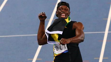 Usain Bolt (JAM) of Jamaica celebrates after the team won the race. © David Gray