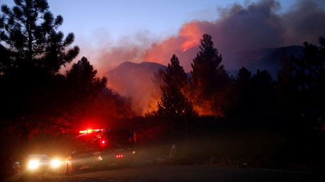 A fire engine risks blazing Lytle Creek Road during the Blue Cut fire in San Bernardino County, California, US August 17, 2016. © Patrick T Fallon