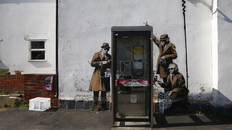 Graffiti art is seen on a wall near the headquarters of Britain's eavesdropping agency, Government Communications Headquarters, known as GCHQ, in Cheltenham, western England  © Eddie Keogh