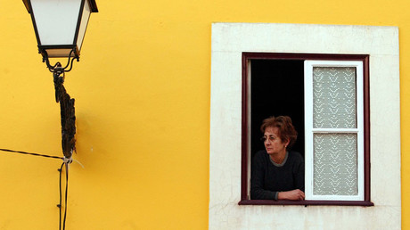 A resident of the downtown area of Leiria city, central Portugal © Nacho Doce