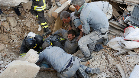 A man is rescued alive from the ruins following an earthquake in Amatrice, central Italy, August 24, 2016. © Remo Casilli