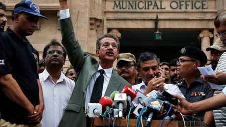 Waseem Akhtar, mayor nominee of Muttahida Qaumi Movement (MQM) political party, gestures while speaking to members of the media (unseen) after the ballot for mayor outside the Municipal Corporation Building in Karachi, Pakistan, August 24, 2016. © Akhtar Soomro