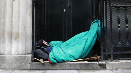A homeless man sleeps in a doorway in central London. © Stefan Wermuth