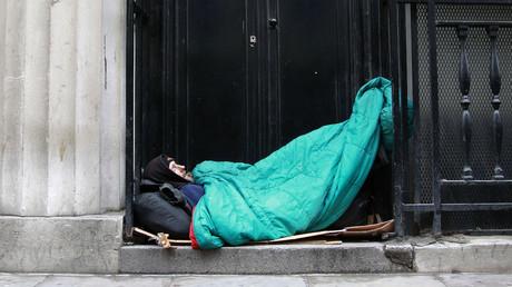 A homeless man sleeps in a doorway in central London. © Stefan Wermuth