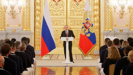 Russian President Vladimir Putin speaks during a personal send-off for members of the Russian Olympic team at the Kremlin in Moscow, Russia. © Maxim Shemetov
