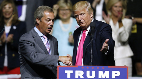 Republican Presidential nominee Donald Trump, right, invites United Kingdom Independence Party leader Nigel Farage to speak during a campaign rally at the Mississippi Coliseum on August 24, 2016 in Jackson, Mississippi. © 