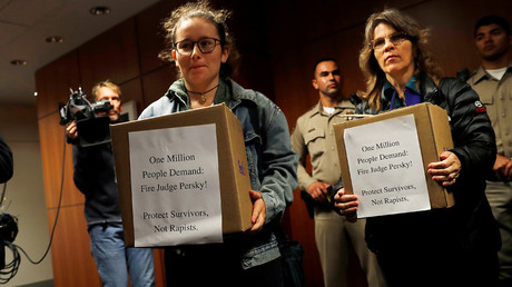 Activists deliver boxes of signed petitions to the California Commission on Judicial Performance calling for the removal of Judge Aaron Persky from the bench after his controversial sentencing in the Stanford rape case, in San Francisco, California, U.S. © Stephen Lam
