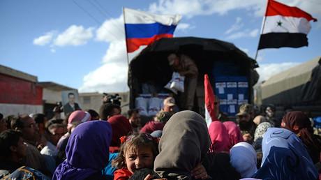 Residents of Kaukab, Syria during the distribution of Russian humanitarian aid. ©Maksim Blinov