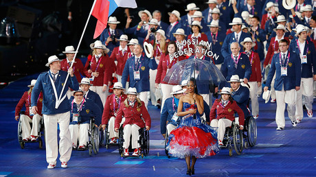 FILE PHOTO: Russia's athletes enter the Olympic Stadium during the opening ceremony of the London 2012 Paralympic Games August 29, 2012 © Suzanne Plunkett