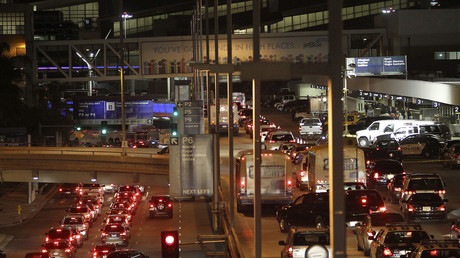 FILE PHOTO: Traffic fills airport streets, passing the Los Angeles International Airport. © David McNew
