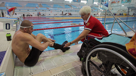 Iskander Mustfayev and his coach Irina Mashchenko during a training session of the Russian Paralympic team in Ruza. ©Vitaliy Belousov