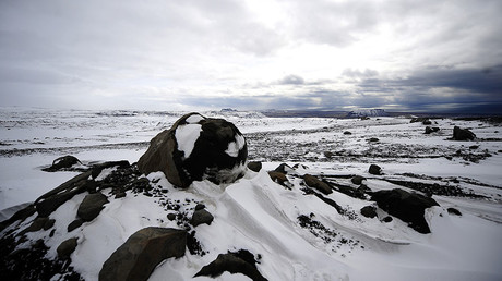 Volcanic boulders sit atop the Myrdalsjokull glacier, which is part of the ice cap sealing the Katla volcano, near the Icelandic village of Vik. © Emmanuel Dunand
