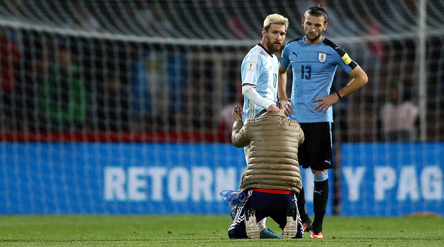 The Messi-ah: Crazed fan kisses Lionel's feet on his Argentina return from retirement (VIDEO)