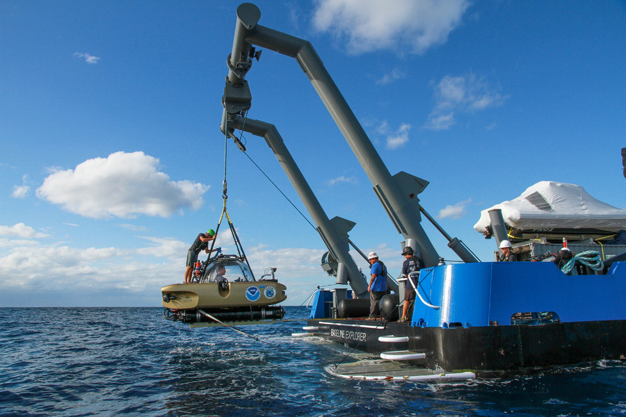 Project Baseline's Nomad submerible is hoisted aboard R/V Baseline Explorer after resurfacing from a dive © David Sybert, UNC Coastal Studies Institute - Battle of the Atlantic expedition