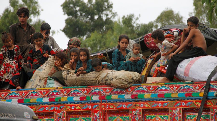 Children sit in the back of a truck as they prepare to return to Afghanistan, at a U.N. refugee repatriation center in Peshawar, Pakistan August 2, 2016. © Fayaz Aziz