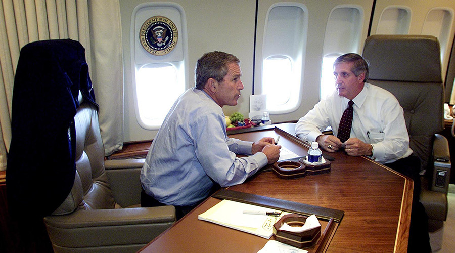 U.S. President George W. Bush talks with Chief of Staff Andrew Card (R) aboard Air Force One during a flight to Offutt Air Force Base in Omaha, Nebraska following a statement about the two planes that crashed into the World Trade Center in New York City, September 11, 2001. © Doug Mills