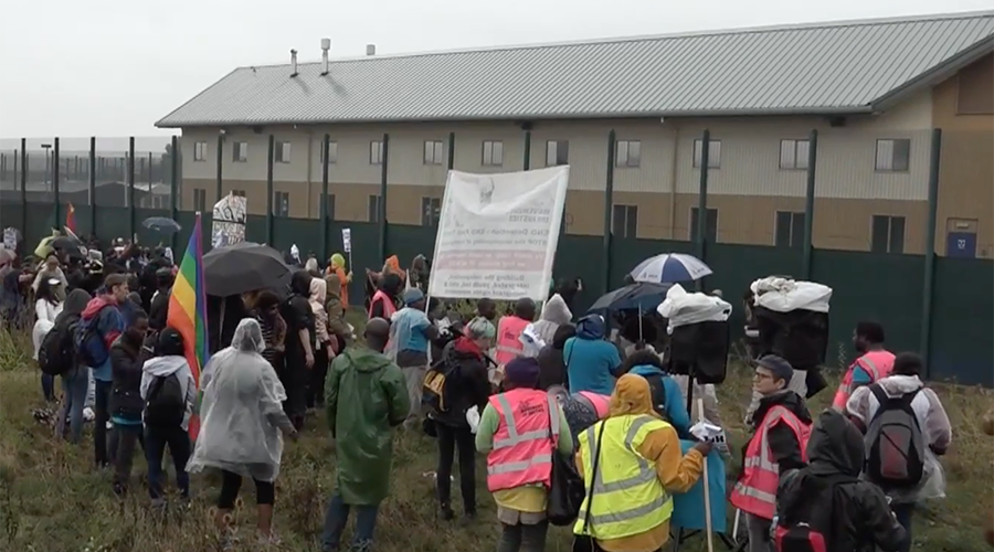 'Shut down Yarl's Wood!' Protesters 'kick down walls' of detention center for deportees