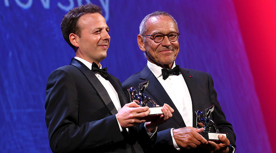 Directors Amat Escalante (L) and Andrei Konchalovsky (R) hold the Best Director award for their respective movies, 'The Untamed' and 'Paradise'. © Alessandro Bianchi
