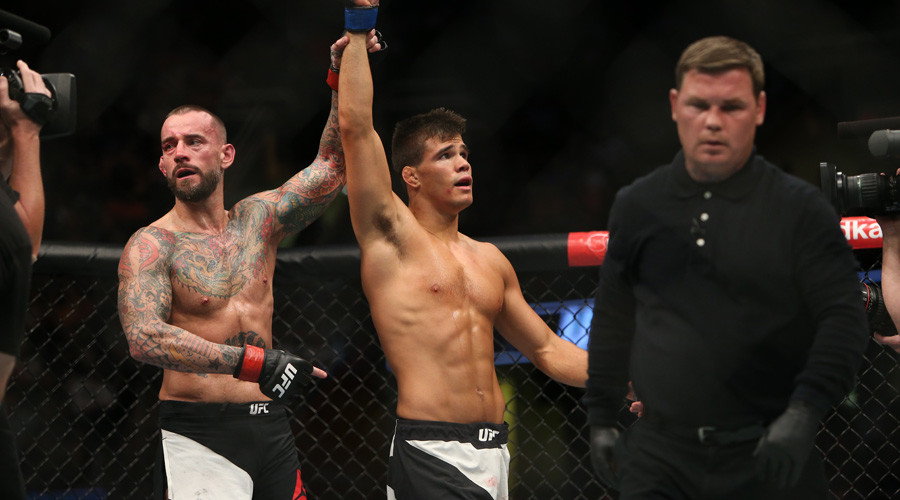 Mickey Gall celebrates his victory over CM Punk during UFC 203 © Rey Del Rio