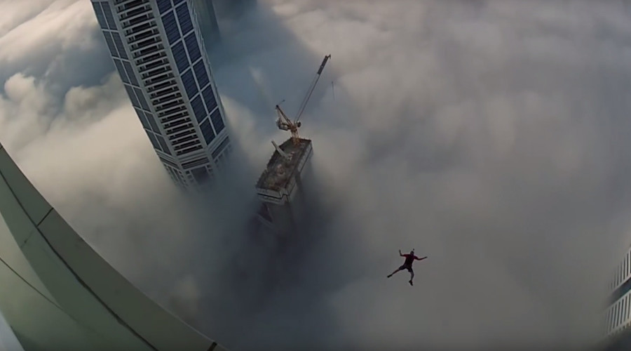 Leap of faith: Dubai base jumper makes blind plunge through clouds (VIDEO)