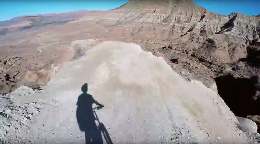 Helmet cam captures mountain biker's death defying desert jump (VIDEO)