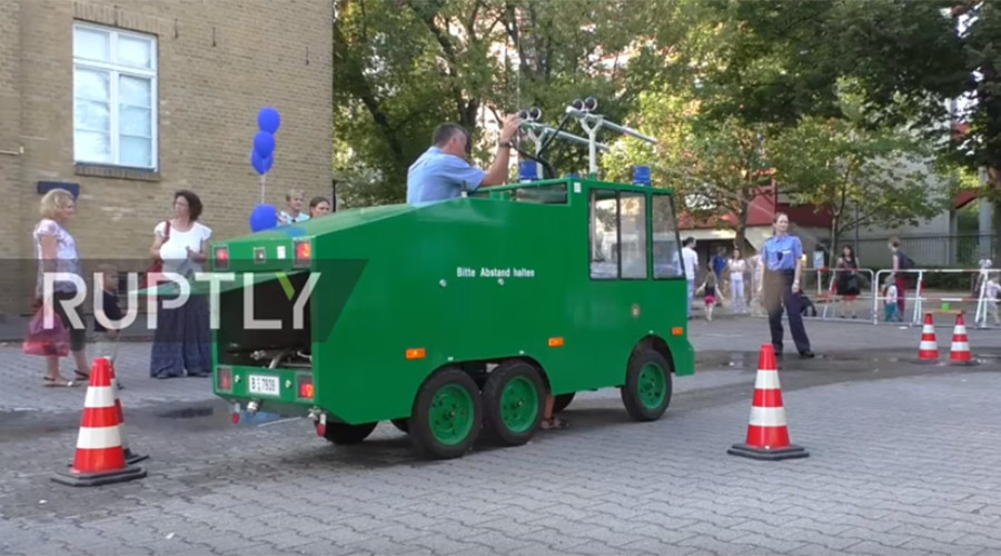 Kids invited to use toy water cannon 'to feel like real policemen' at Berlin festival