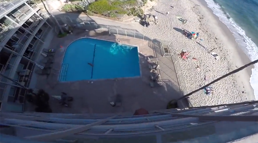 Crazy multi-story swimming pool jump caught on camera (VIDEO)