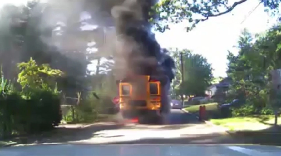Driver saves 20 kids from burning school bus (VIDEO)