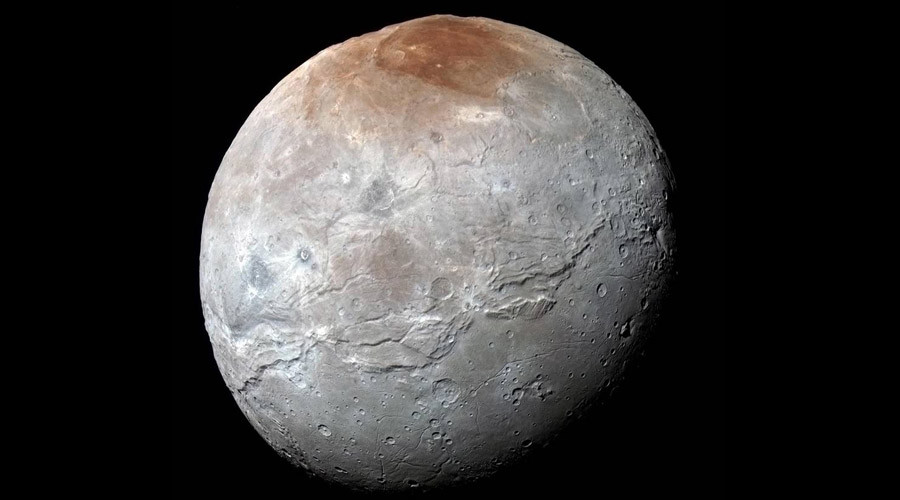 Pluto's painting: Dwarf planet uses methane to 'graffiti' its largest moon Charon