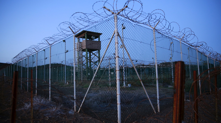 Chain link fence and concertina wire surrounds a deserted guard tower within Joint Task Force Guantanamo's Camp Delta at the U.S. Naval Base in Guantanamo Bay © Lucas Jackson