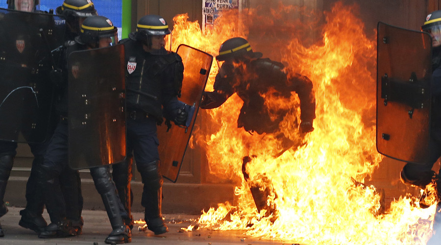 Policeman engulfed in flames triggers fury against French protesters (PHOTO)