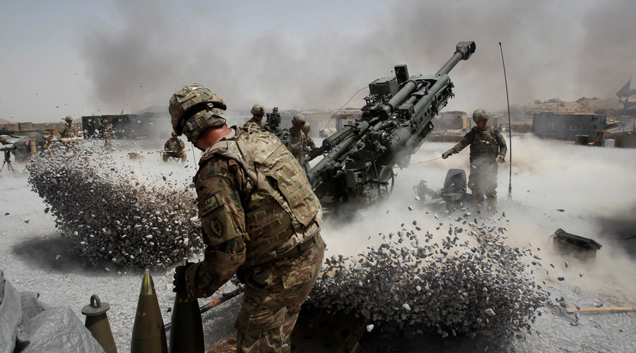 U.S. Army soldiers from the 2nd Platoon, B battery 2-8 field artillery, fire a howitzer artillery piece at Seprwan Ghar forward fire base in Panjwai district, Kandahar province southern Afghanistan © Baz Ratner