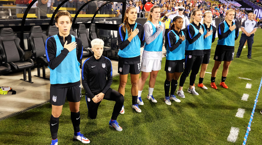 USWNT's Megan Rapinoe kneels during the U.S. National Anthem before a match against Thailand  © Jamie Sabau