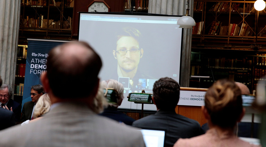 Edward Snowden speaks via video link during the Athens Democracy Forum, organised by the New York Times, at the National Library in Athens, Greece, September 16, 2016. © Alkis Konstantinidis