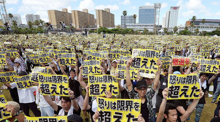 "Protesters raise placards reading""Anger was over the limit""during a rally against the U.S.military presence on the island and a series of crimes and other incidents involving U.S.soldiers and base workers, at a park in the prefectural capital Naha on Japan's southern island of Okinawa,Japan. © Kyodo"