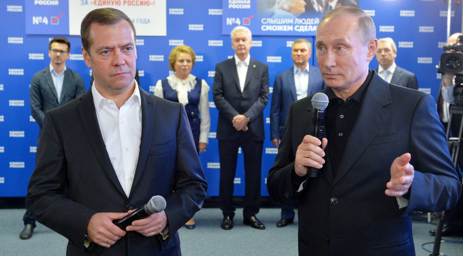 Foreground, from right: Russian President Vladimir Putin and Russian Prime Minister and chairman of the United Russia political party Dmitry Medvedev at the party's election campaign headquarters, September 18, 2016. © Alexei Druzhinin