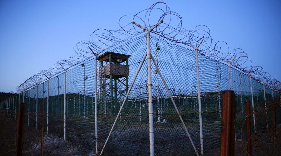Chain link fence and concertina wire surrounds a deserted guard tower within Joint Task Force Guantanamo's Camp Delta at the U.S. Naval Base in Guantanamo Bay, Cuba. © Lucas Jackson