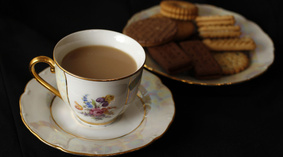 A cup of tea and plate of biscuits, London. © Suzanne Plunkett