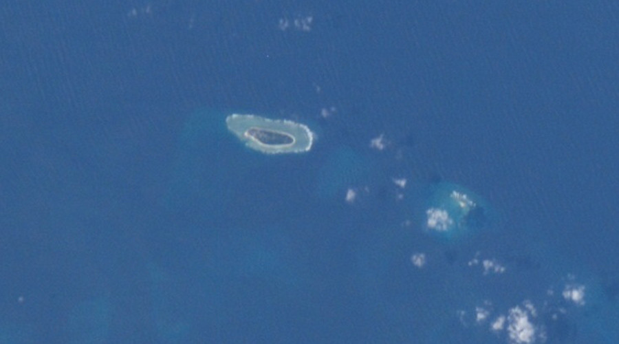 Image of Taiping Island (also known as Itu Aba Island, left) and Zhongzhou Reef (right) taken aboard the International Space Station. © NASA