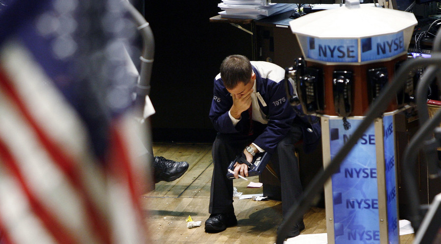 A trader puts his hand to his face while working on the floor of the New York Stock Exchange in New York,  2007 © Shannon Stapleton