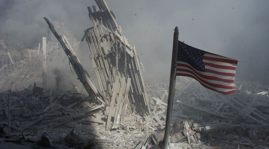 Am American flag flies near the base of the destroyed World Trade Center in New York, September 11, 2001. © Peter Morgan