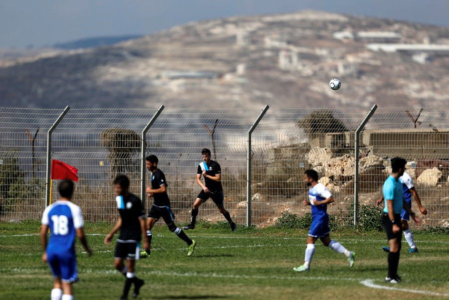 Players from Israeli football clubs affiliated with Israel Football Association, Ariel Municipal Soccer Club and Maccabi HaSharon Netanya, play against each other at Ariel Municipal's training grounds in the West Bank Jewish settlement of Ariel © Amir Cohen
