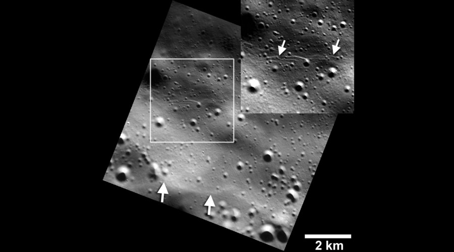 Small graben, or narrow linear troughs, have been found associated with small fault scarps (lower white arrows) on Mercury, and on Earth's moon. © NASA