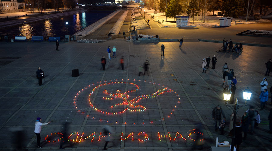 """Protest against abortion """"One of Us"""" on Plotinka in Yekaterinburg. 600 lamps placed by protesters form a silhouette of ??a 12-week fetus in the womb. © Pavel Lisitsyn"""