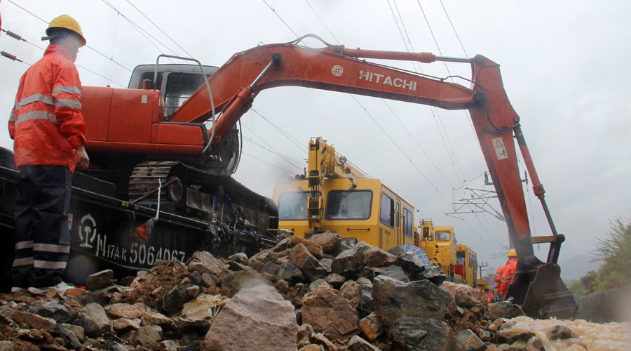 Rescue workers try to recover a railway line affected by Typhoon Megi in Fujian province. © Stringer